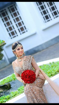 Beautiful Indian bride in gold and crystal encrusted saree.