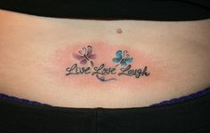 live love laugh tattoo w/ butterflies <3 - I like this one - maybe with dragonfly's or daisy's - and not on my back