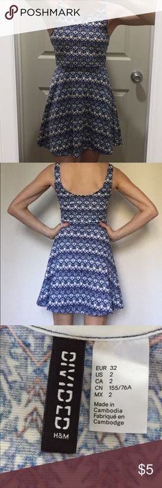 """H&M Divided Spring or Summer Dress This is an awesome feels like you're wearing sweats, but you're in a cute sundress kind of dress. Round scoop neckline; cut lower in back. Fitted at waist with slight flare toward hemline. I'm 5'3"""" and the length hits me in a flattering spot, just above the knee. Funky, fun kind of bohemian pattern with blues, cream, and just a touch of orange. This is a super comfy dress for those warm spring & summer days. In terrific shape, only worn a few times. H&M…"""