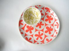 Hand built serving tray with a coral pink spinning pattern on the front and lime pattern on the underside. Matching patterned sauce bowls