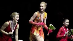 Gold medalist Anna Pogorilaya of Russia, center, poses with her medal with silver medalist Ashley Wagner of the United States, left, and bronze medalist Satoko Miyahara of Japan share a laugh following the ice dance free dance program at Skate Canada International in Kelowna, British Columbia, Saturday, Nov., 1, 2014. (AP Photo/The Canadian Press, Jonathan Hayward)