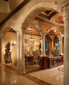 Talk about fancy! Marble, statues, and that gorgeous dining room. Look at the arches!