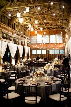 loved to get married in a place like this. barn like with long community tables
