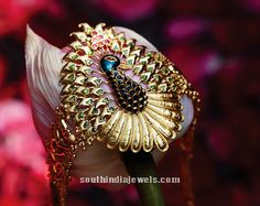 Stylish gold peacock bracelet design from Tanishq. For inquiries please contact 1800-108-1100.