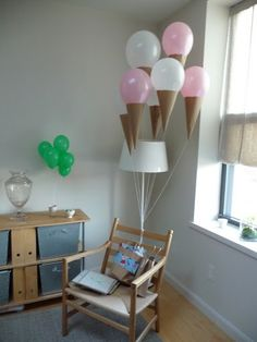 How to make ice cream cone balloons:    Martha's Crafts Department has some great baby shower ideas. This one is particularly noteworthy as it's perfect for little ones' birthday parties too. So simple to make, all you have to do is make cone shapes out of craft paper and attach them to helium-filled balloons. Darling!
