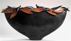 Sang Roberson's burnished, terra cotta containers are hand-built from slabs of clay....Google Image Result for http://www.hibberdmcgrath.com/images/leafBowl.jpg