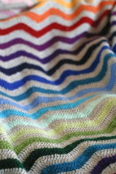 Chevron crochet afghan with chromatic color design. Maybe stick to the idea of a constant yarn every other row and use up whatever random yarns I have in between???