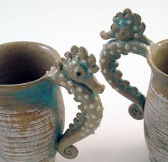 These stand 6.5 inches tall, 3.25 inches wide and 5.5 inches wide at the handle. by Liz of SkyBird Arts Pottery Saugatuck, MI Hold about 1.3 cups
