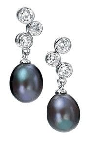 A gorgeous pair of rhodium plated sterling silver earrings by award winning designer Elements Silver with triple clear cubic zirconia stones and freshwater pearl drop.