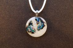 Iridescent white dichroic glass pendant with blue and black accents from Ivy Tree Designs. $19.00
