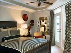 CHERYL'S THOUGHTS:  Usually, matching drapes and spread would be too much for such a small space.  Choosing the right accessories and colors is what makes this work so well.  Beautiful Room.  10 Small Bedroom Designs   HGTV