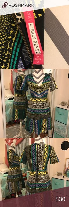 Plenty by Tracey Reese tribal print dress Beautiful tribal printed dress from anthropology. Short sleeves. Blue/white/green/ and black colors in the pattern. Comfortable for any occasion. Feel free to make an offer Anthropologie Dresses Midi