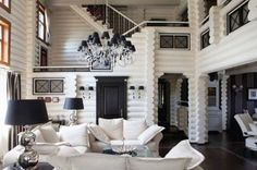 White painted log cabin style. Black accents.