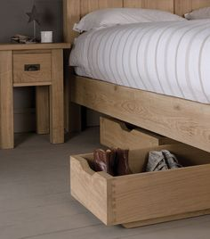 Organise your sleeping space with an Indigo Under Bed Oak Shoe Drawer. Handcrafted and designed to slide neatly under your bed. #shoedrawer #solidwood #indigofurniture