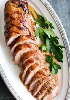 Easy! Pork tenderloin marinated in orange marmalade sauce, grilled and then glazed with more sauce. So good! On http://SimplyRecipes.com