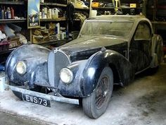 """1937 Bugatti Type 57S Atalante Coupe - """"This is probably the most well-known – and most valuable – barn finds of all time. The one-of-17 Bugatti was bought by a British doctor in 1955, then stored in his garage in the early 1960s. Family members unearthed the car after his death in December 2008; in February 2009, it sold in unrestored condition for $4.53 million."""""""