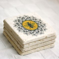 Coasters- French Bee with crown and flowers, set of 4. French Country Home Decor on tumbled stone. By MilkandHoneyLuxuries. $25.00, via Etsy.