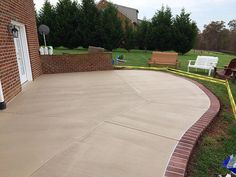 Stained Concrete Patio With A Sprayed Concrete Brick Border In Goode Concrete Patio Edging Concrete Patio Cost Concrete Patios, Concrete Patio Designs, Concrete Bricks, Cement Patio, Brick Patios, Stained Concrete, Colored Concrete Patio, Cement Driveway, Flagstone Walkway