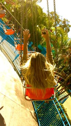 an amusement park swing ride reminds me of the fun and flirtatious side of the perfumes