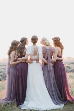 """This serene and peaceful snap says, """"we have each other's backs."""" Not only does it capture a moment of reflection, but it's a great way to show off your train and the back of the bridesmaids' dresses.Related:70+ Wedding Gowns That Are Even More Beautiful from the Back"""