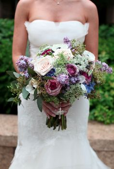 Cascading and generous bridal bouquet full of large pin, purple, and blue blossoms | Weddingful Chicago wedding vendors - A Stem Above - flowers & decor  Follow link to view vendor profile