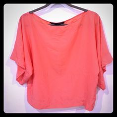 Zara Coral boat neck chiffon top. Size S Beautiful coral colored Zara crop top (wide loose style) super soft chiffon type material. Size Small. Can fit M. Perfect summer color! Goes perfectly with white in great condition worn once or twice. Selling cheap!! Zara Tops Blouses