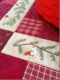 """""""Snowman Garland"""" (close up) with wool appliqued snowman heads"""