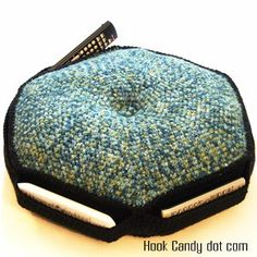 This crocheter has some really cute patterns for baby booties and hats, and a few practical items like this--a remote control caddy/pillow.  What a great idea!