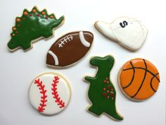 Boy sugar cookies with Royal icing dinosaurs and sports