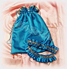 handcuff charms bridal garter set and money dance bag. Thin blue police wedding leg garter set and drawstring bag