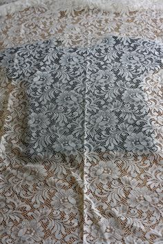 DIY//bleach lace pattern shirt by rebeccacaridad, via Flickr~~~lace + spray bleach bottle + colored fabric = bleached lace design