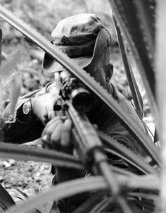 Sniper, Vietnam war - 1969 - U.S. Army 9th Infantry Division sniper Sergeant Adelbert F. Waldron, III, with XM21 rifle. Sergeant Waldron had 109 confirmed kills to his credit and earned two Distinguished Service Crosses for his outstanding skill and bravery.