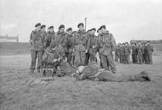 Men of the Belgian Army learn to use a Bren gun as part of their Commando training at a British Commando School. The NCO records to the second the time allowed for firing.