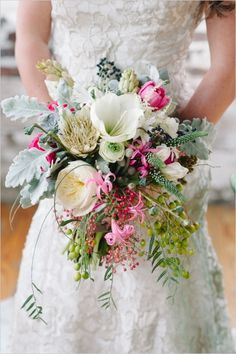 eclectic cascading bouquet #bouquet #eclecticbouquet #weddingchicks http://www.weddingchicks.com/2014/04/09/illuminated-industrial-wedding-ideas/