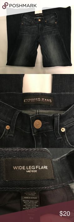 "Express Wide Leg Flare Jeans New without tags, never worn. Express mid rise Wide Leg Flare Jeans with dark wash. Measurements laying flat are 43"" length from top to bottom, 34"" inseam, 14"" waist. Please see pics for material content. Express Jeans Flare & Wide Leg"
