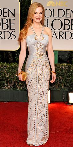 Metallic, skintight beaded Versace halter gown paired with a golden Roger Vivier clutch and Fred Leighton jewels.