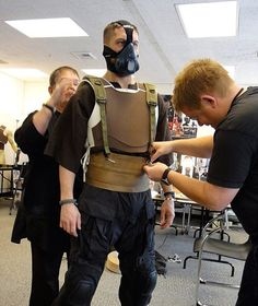 Tom at an early fitting for his Bane costume.    Wow. That looks … odd. I wouldn't have recognised Tom.