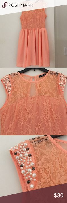 Beautiful Coral Beaded Lace Dress! This coral dress is the perfect item to wear to any occasion. It has beaded sleeves and the top part is lace! It has a keyhole back. Some beads are loose but nothing a quick sew couldn't fix:-) Dresses Midi
