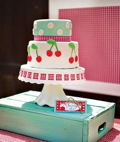 Cherry on top themed birthday party cake with polka dots and cherry pairs