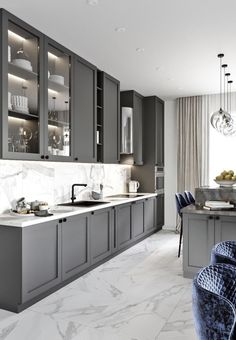 We like the mix of top cabinet (some with glass covers and some solid opaque covers) Grey Kitchen Designs, Kitchen Room Design, Kitchen Cabinet Design, Modern Kitchen Design, Home Decor Kitchen, Interior Design Kitchen, Home Kitchens, Grey Kitchens, Kitchen Ideas