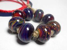Lampwork. Glass bead handmade. Beads blue, red, orange, purple.