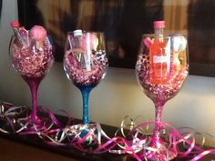 DIY glitter wine glasses: Mod Podge stem, use glitter color of your choice, and add another layer of Modge Podge. I filled these with pink tinsel, mini bottles of liquor, animal print socks, pack of gum, mini nail file, animal print tweezers, noise maker, pink party bracelets.