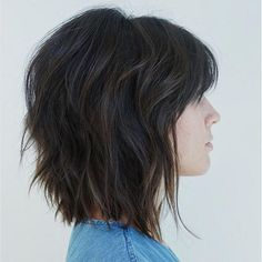 Feb 2020 - Pretty Shaggy Brunette Bob The sassy brunette bob is a modern twist on the traditional short shag haircut. Slight teasing in the crown gives it a little extra height, and the wispy bangs swept to the side emphasize the eyes and cheekbones. Shaggy Layered Bobs, Layered Bob With Bangs, Bob With Layers, Angled Bobs, Inverted Bob, Layered Short Hair, Thick Short Hair, Angled Hair, Wavy Layers