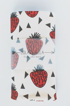 We love this strawberry print design printed on 100% organic cotton knit.  Our stylish blanket features cotton produced in the USA that is