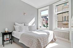 Bedroom // Farrow & Ball Pavilion Grey walls. Off-white wool carpet Kasthall. Quilt by Hay. Rubn Vox lamp. Mille Notte bed linen // Karlbergsvägen 41, Stockholm, Sweden