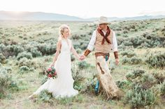 A bride with old west glam and her cowboy groom walking off into the Montana sunset.