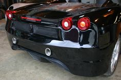 Black Ferrari F430 replica based on Toyota MR2 roadster built by XLR8.me.uk from EDF430 bodykit Detail pictures of the high level Scuderia style exhaust fitted