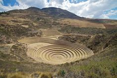 Peru - Sacred Valley & Incan Ruins 279 - Moray  The gorgeous circular terraced bowl of Moray are thought to be an experimental agricultural nursery for the Incas, with different micro-climates allowing for different varieties of corn to be planted at deeper levels of the circular bowl. Others, both locals and foreign spiritually-minded, feel such a technical explanation fails to match the obvious effort, aesthetics and position the amazing circular site took.