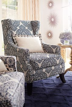 Pier 1's Alec Wing Chair is already a new twist on a timeless classic, with its traditional wingback style in a sleek profile. We added yet another twist by updating it with new indigo upholstery. We've done all the twisting for you so you won't need to—especially once you're comfortably seated on the tailored box cushion.