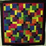 Tossed 9 Patch.  They used the border fabric only in the center square which adds such interest without overpowering and yet tying in the border.  This pattern is from Elenor Burns.  Super super easy and a GREAT beginner quilt for all ages!